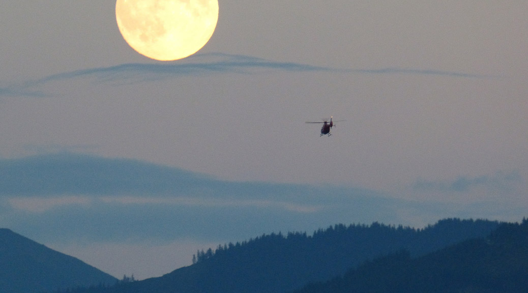 Helicopter in a smoky sky